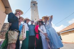 A group of young stylish European people travel together, have fun, in the historic. Center of Galle, Sri Lanka, a trip to Asia, the island of Ceylon stock photos