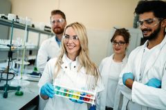 Group of young successful scientists posing for camera Royalty Free Stock Photos