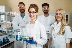 Group of young successful scientists posing for camera Stock Photography