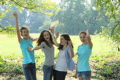 Group of young teenage friends cheering Royalty Free Stock Photo
