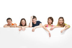 A group of young teenagers hanging on a billboard Stock Photo