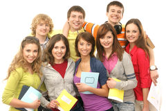 A group of young teenagers holding notebooks Royalty Free Stock Photo