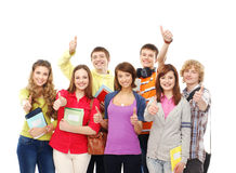 A group of young teenagers holding notebooks Royalty Free Stock Photos