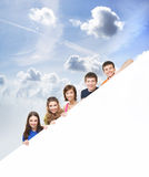 A group of young teenagers holding a white banner Royalty Free Stock Images