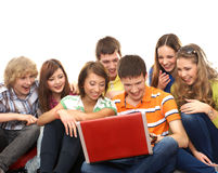 A group of young teenagers looking at the laptop Stock Photo