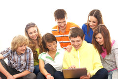 A group of young teenagers looking at the laptop Royalty Free Stock Photography