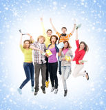 A group of young teenagers on a snowy background Stock Photography
