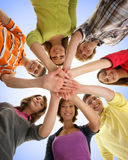 A group of young teenages holding hands together Royalty Free Stock Image
