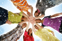 A group of young teenages holding hands together. A group of young and happy Caucasian teenagers in modern clothes holding hands together. The image is taken on Royalty Free Stock Photography