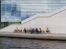 Group of young tourists on a bike tour in Berlin Royalty Free Stock Photography