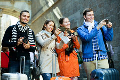 Group of young tourists with cameras Stock Images