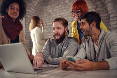 Group of young web designers working Royalty Free Stock Image