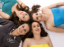 Group of young women. Group of young woman lying on a white background stock photos
