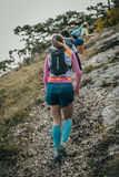 Group of young women athletes climb mountain one after another Royalty Free Stock Image