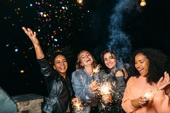 Group of young women celebrating new years eve outdoors Royalty Free Stock Image