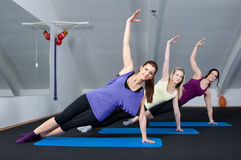Group of young women doing aerobic exercises Royalty Free Stock Photo
