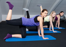 Group of young women doing butt exercises Royalty Free Stock Images