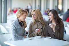 Group of young women drinking coffee stock images