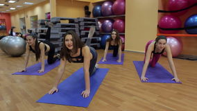 Group of young women in fitness class making exercises for the legs. stock footage