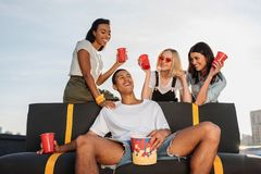 Women flirting with young man on party. Group of young women flirting with handsome men on party royalty free stock photos