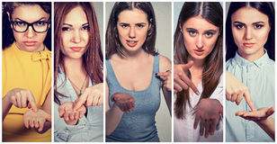 Group of young women gesturing with hand to pay back money royalty free stock images