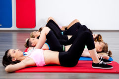 Group of young women in the gym centre. Performing aerobics stock photography