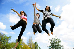 Group of young women jumping. Young women jumping, mid-air, portrait Stock Image