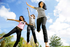 Group of young women jumping. Three young women jumping, in mid-air, portrait Stock Images