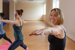 A group of young women performs yoga asanas. Close up stock photography