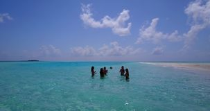 V08437 group of 5 young women playing ball with view from aerial drone on sunny island white beach blue sea sky water royalty free stock photography
