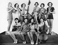 Group of young women playing instrument Stock Images