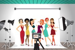Group of young women posing in photo studio on white background. Royalty Free Stock Photography
