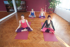 Group of young women practicing yoga Stock Images