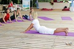 Group of young women practises yoga Stock Image