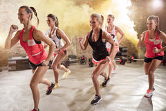 Group of young women in running pose Royalty Free Stock Image