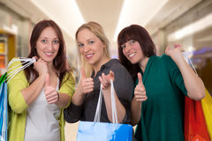 Group of young women with shopping bags Royalty Free Stock Image