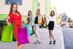Group of young women shopping. Royalty Free Stock Photography