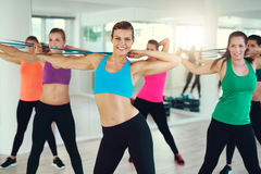 Group of young women stretching arms Royalty Free Stock Photo
