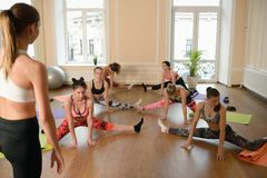 Group young women stretching and practices yoga Stock Image