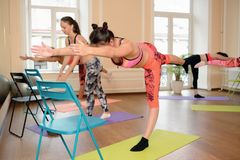 Group young women stretching and practices yoga Stock Photo