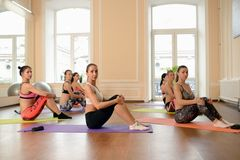Group young women stretching and practices yoga Royalty Free Stock Image