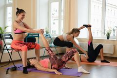 Group young women stretching and practices yoga Royalty Free Stock Photos
