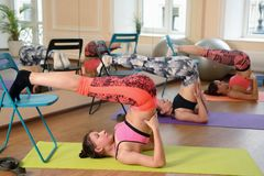 Group young women stretching and practices yoga Stock Photos