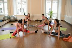 Group young women stretching and practices yoga Stock Photography