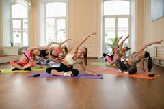 Group young women stretching and practices yoga Royalty Free Stock Photography