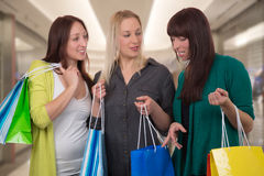 Group of young women talking about their purchase in shopping ma Royalty Free Stock Image
