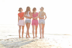 Group of young women walking on beach. Summer vacation, holidays, travel, friendship and people concept - group of young women walking on beach stock images