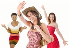 Group of young women waving hands in summer dress Stock Images