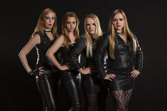 Group of young women wearing leather outfits Royalty Free Stock Photo