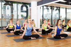 Group of young women in yoga class Stock Images